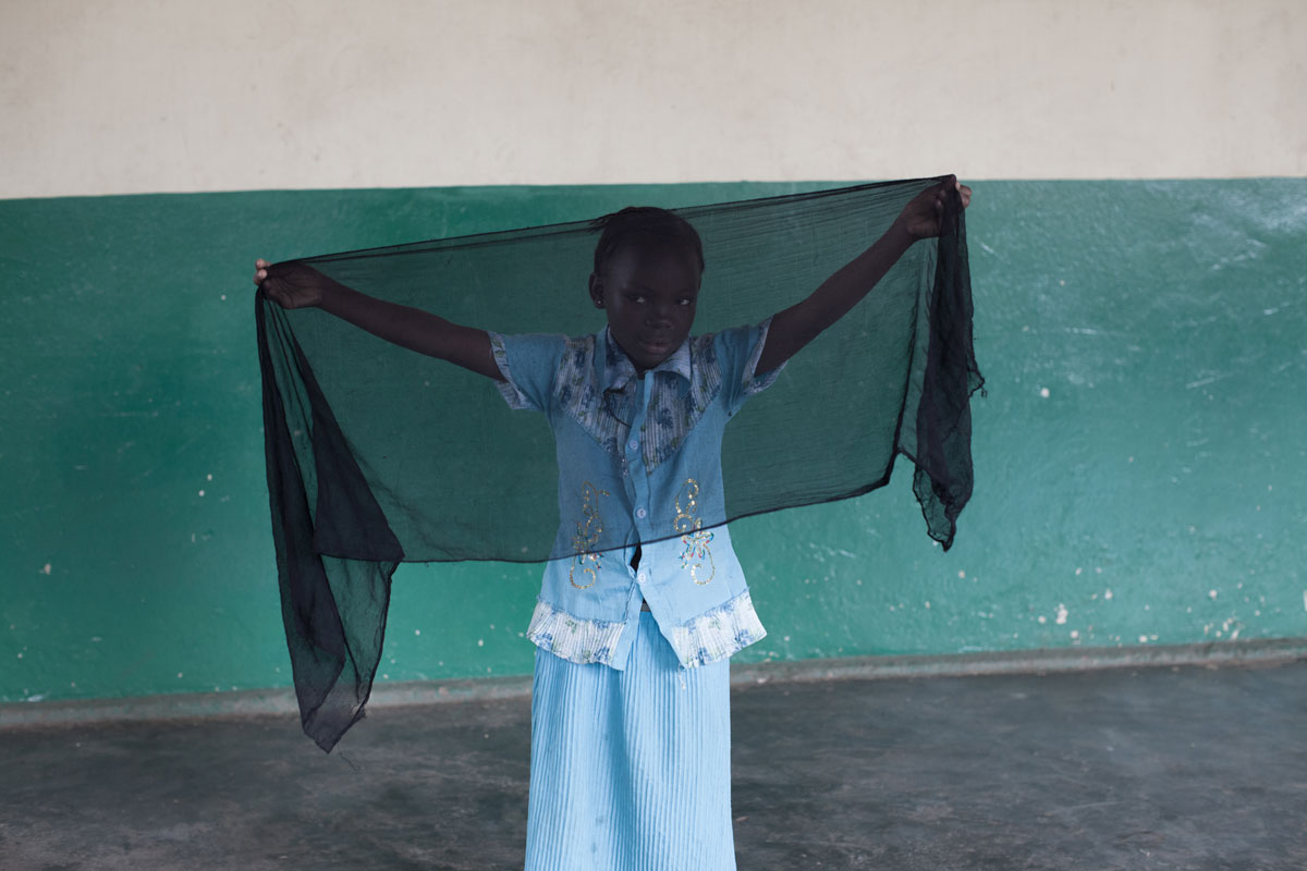 Girl in Bangui, Central African Republic holding a prayer scarf