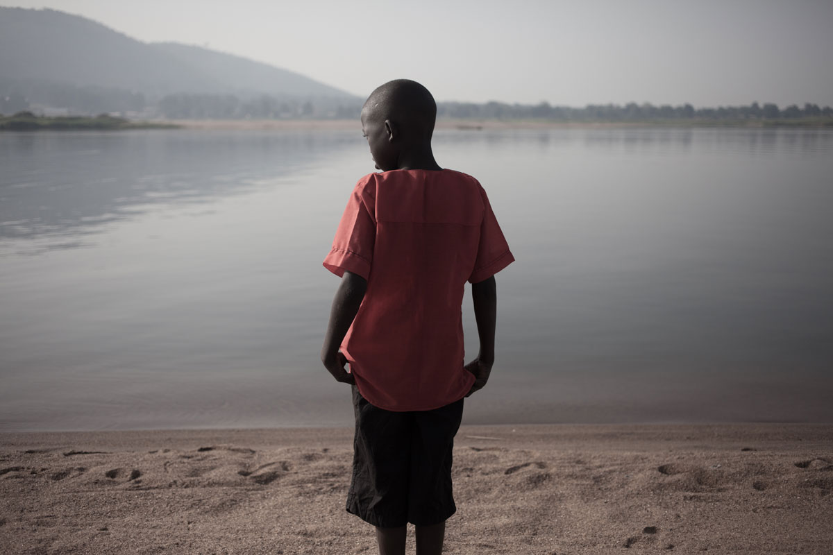 Boy at the shore of the Ubangui river, Bangui, Central African Republic