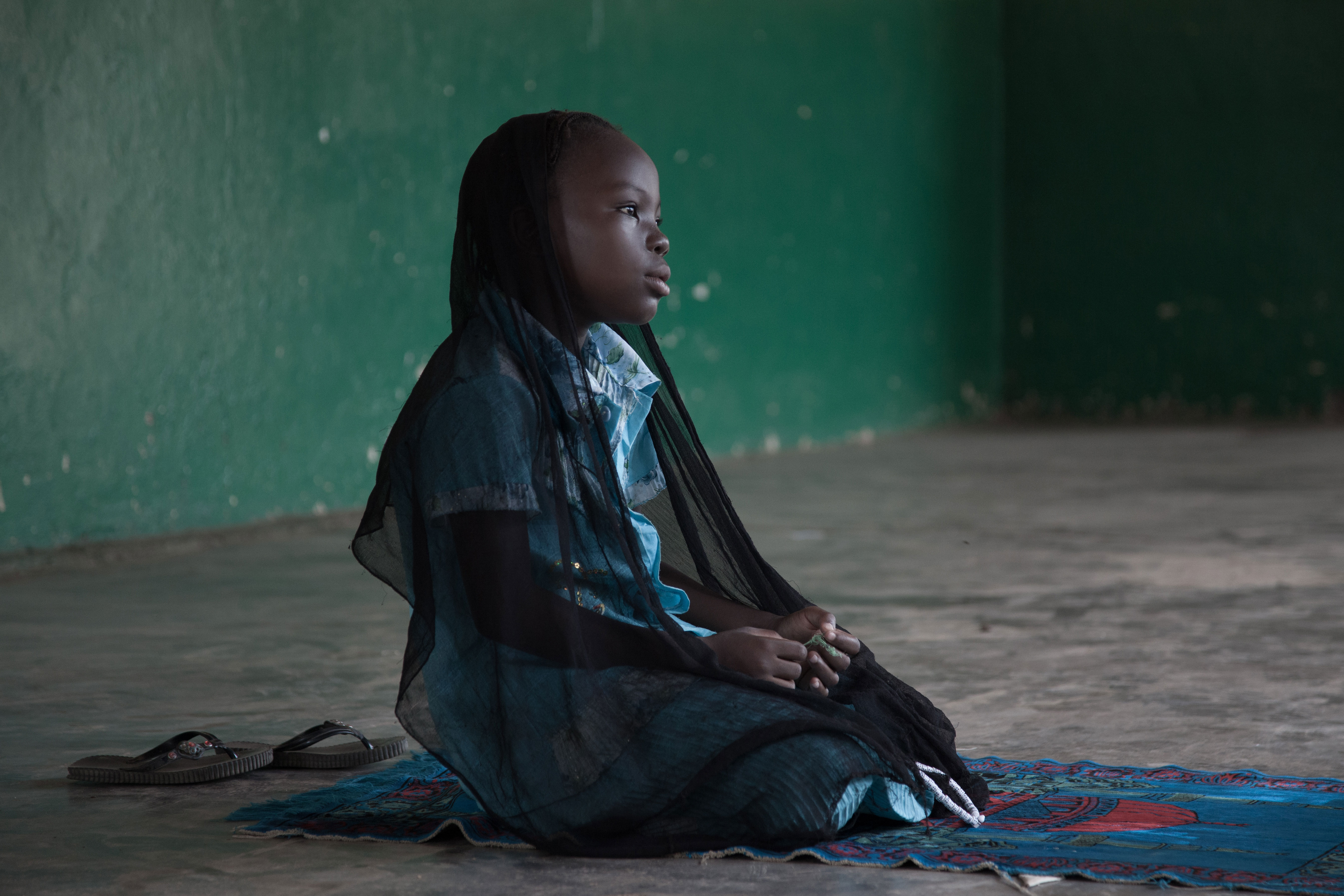 Girl praying at the Mosque, PK5 Quarter, Bangui, Central African Republic