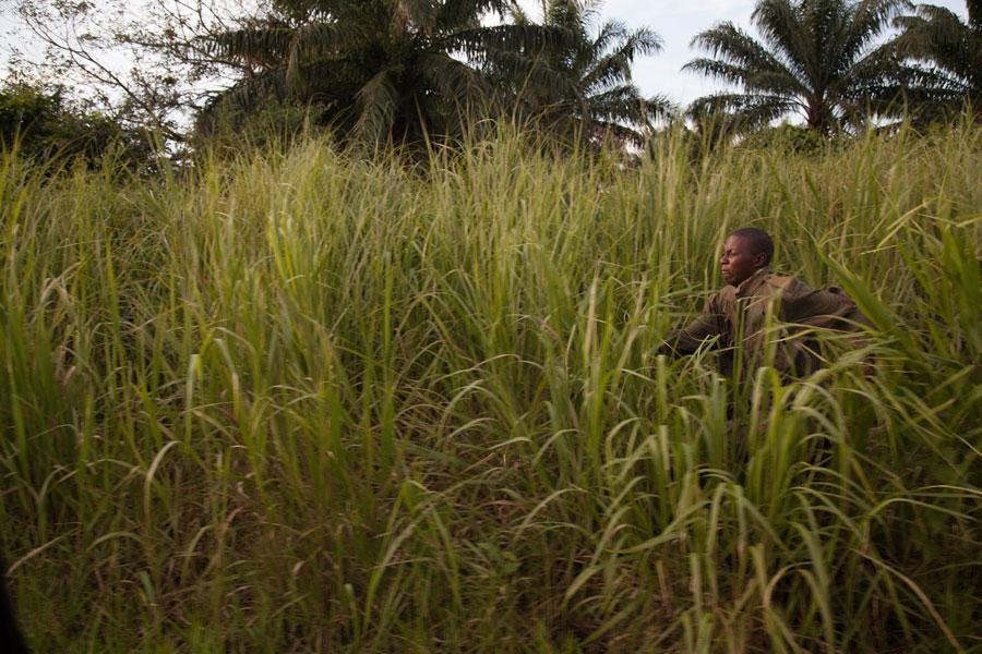 Escaped LRA child soldier runs through the grass, northeastern Democratic Republic of Congo